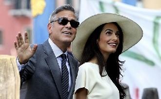 Amal Clooney terhes?